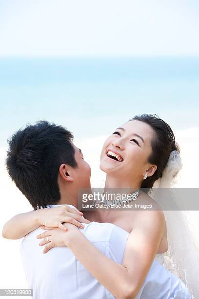 Newlyweds Having Fun on the Beach