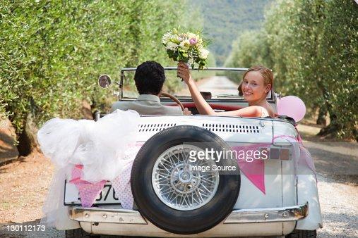 Newlyweds in classic car
