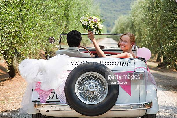 Newlyweds in classic car