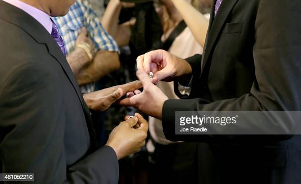 Newlyweds Jeff Delmay and Todd Delmay exchange rings during a marriage ceremony in the MiamiDade court room of Circuit Judge Sarah Zabel on January 5...