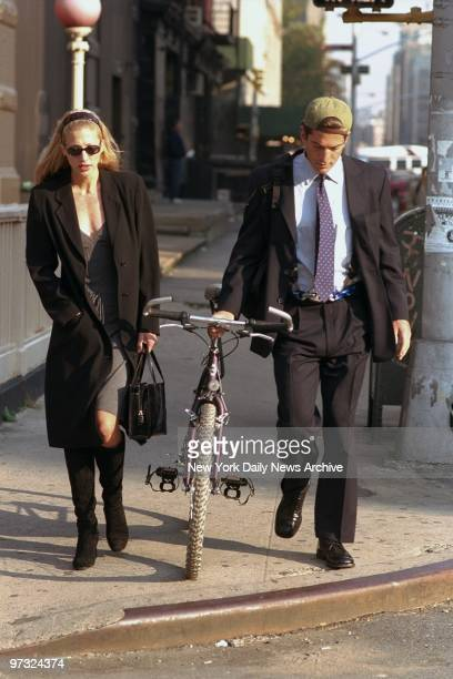 Newlyweds John F Kennedy Jr and Carolyn Bessette Kennedy walk along Varick St