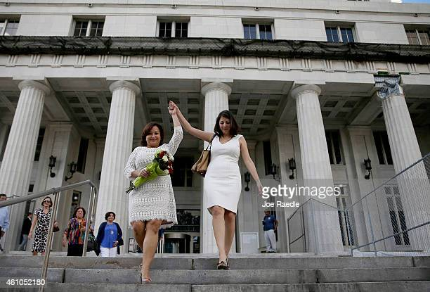 Newlyweds Karla Arguello and Catherina Pareto walk out of the MiamiDade courthouse as the first couple to marry in Florida after Circuit Judge Sarah...