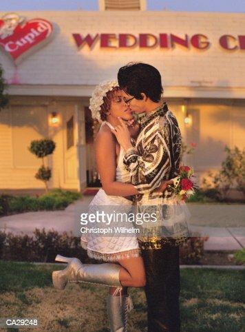 Newlyweds kissing outside wedding chapel, Las Vegas, Nevada, USA