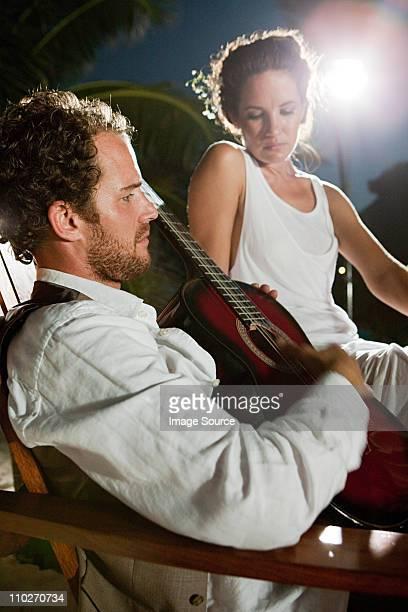 Newlyweds, man playing guitar
