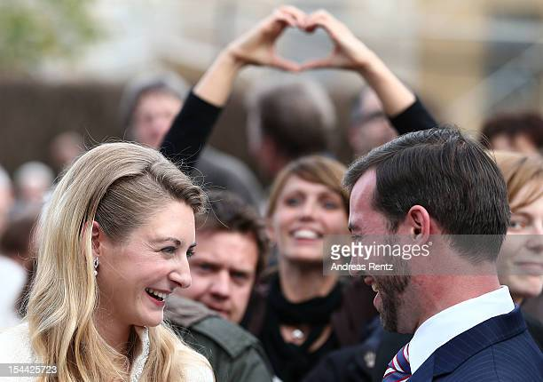 Newlyweds Princess Stephanie and Crown Prince Guillaume of Luxembourg walk amongst the crowds following the civil ceremony for the wedding of Prince...