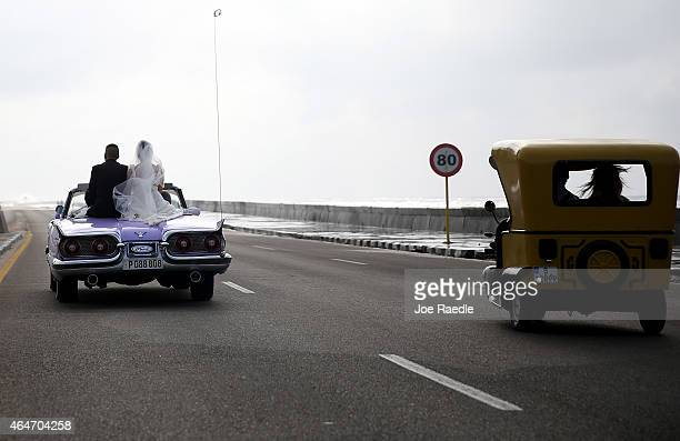 Newlyweds ride through the streets in an vintage American car as the second round of diplomatic talks between the United States and Cuban officials...