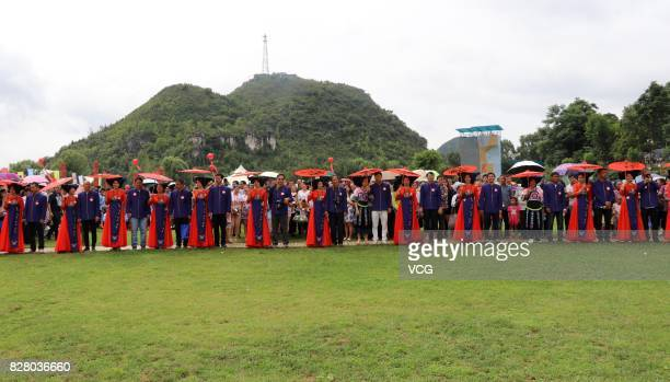99 newlyweds step over braziers and saddles during their group wedding ceremony at a camp site on August 8 2017 in Qiandongnan Guizhou Province of...