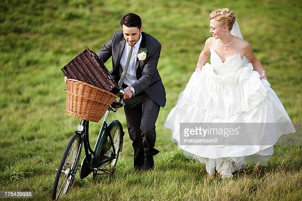 Newlyweds walking through the countryside