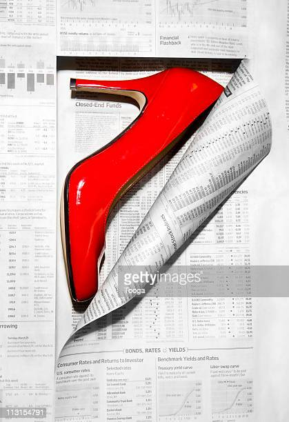 Newpaper revealing woman's red shoe
