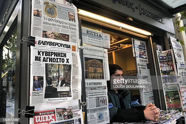Newpapers are displayed at a newstand in Athens on November 9 2011 Calls for Greece's top two parties to quickly name a unity government grew on...