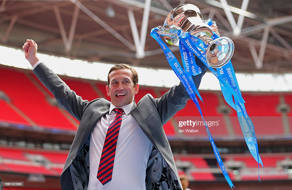 Newport County A.F.C manager Justin Edinburgh celebrates with the trophy after winning the Blue Square Bet Premier Conference Play-off Final between Wrexham and Newport County A.F.C at Wembley Stadium on May 5, 2013 in London, England.