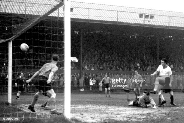 Newport County's first goal is scored by their insideright Burton over Brentford's fallen goalkeeper Cakebread in the Third Division match at...