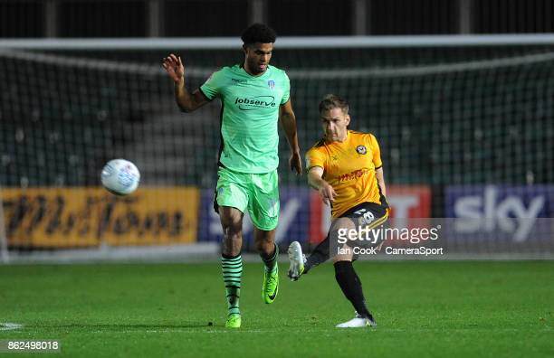 Newport County's Mickey Demetriou battles with Colchester United's Mikael Mandron during the Sky Bet League Two match between Newport County and...