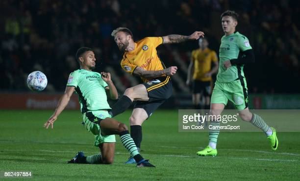 Newport County's Sean Rigg has a shot at goal during the Sky Bet League Two match between Newport County and Colchester United at Rodney Parade on...