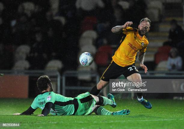 Newport County's Sean Rigg is tackled by Colchester United's Tom Eastman during the Sky Bet League Two match between Newport County and Colchester...