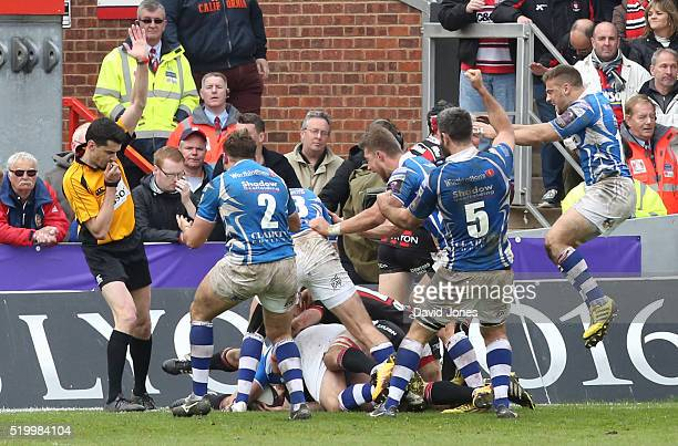 Newport Gwent Dragons players celebrate as Charlie Davies scores the winning try against Gloucester Rugby during the European Rugby Challenge Cup...