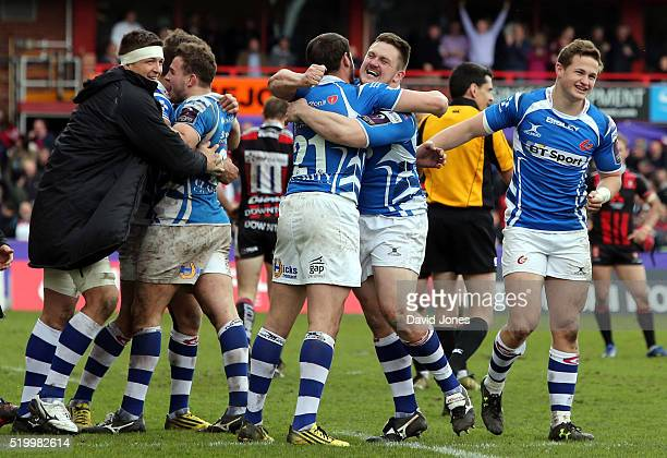 Newport Gwent Dragons players celebrate their victory over Gloucester Rugby during the European Rugby Challenge Cup match between Gloucester Rugby...
