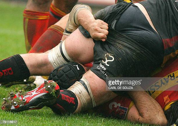 A Newport Gwent Dragons' rugby player has his shorts pulled down during their Round 6 European Cup Rugby Union match at home to Newport at Rodney...