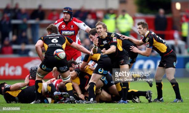 Newport Gwent Dragons' Wayne Evans gets a move started during the EDF Energy Cup match at Kingsholm Stadium Gloucester