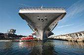 Newport News, Virginia, August 25, 2013 - The aircraft carrier USS Theodore Roosevelt (CVN-71) pulls out of Newport News Shipyard.