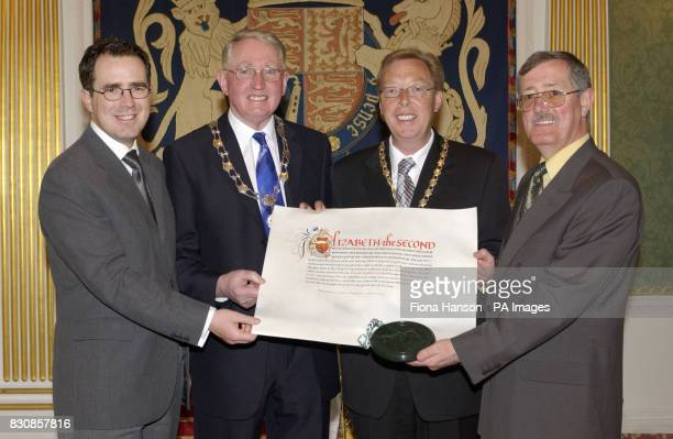 Newry dignitaries hold the Letters Patent endorsed by the Great Seal confering city status on Newry Northern Ireland presented to the ViceChairman of...