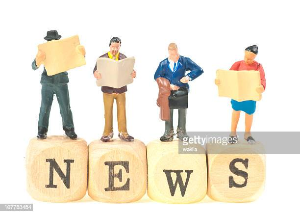 news abstract picture with small figurines
