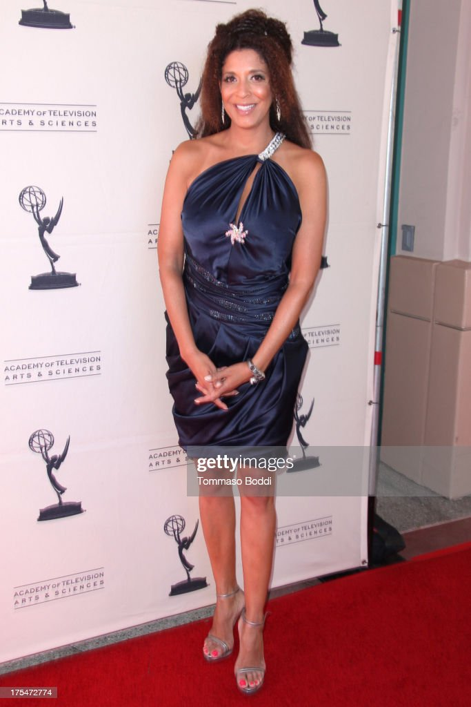 News anchor <a gi-track='captionPersonalityLinkClicked' href=/galleries/search?phrase=Christine+Devine&family=editorial&specificpeople=2179636 ng-click='$event.stopPropagation()'>Christine Devine</a> attends the Academy Of Television Arts & Sciences 65th Los Angeles Area EMMY Awards held at the Leonard H. Goldenson Theatre on August 3, 2013 in North Hollywood, California.