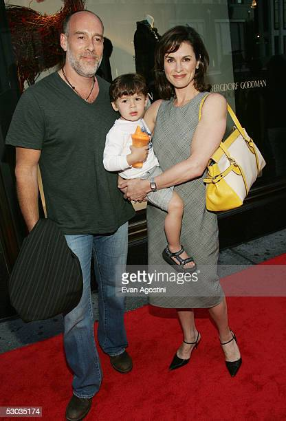 News anchor Elizabeth Vargas husband Marc Cohn and son Zachery arrive at a party for Madonna's new children's book 'Lotsa De Casha' at Bergdorf...