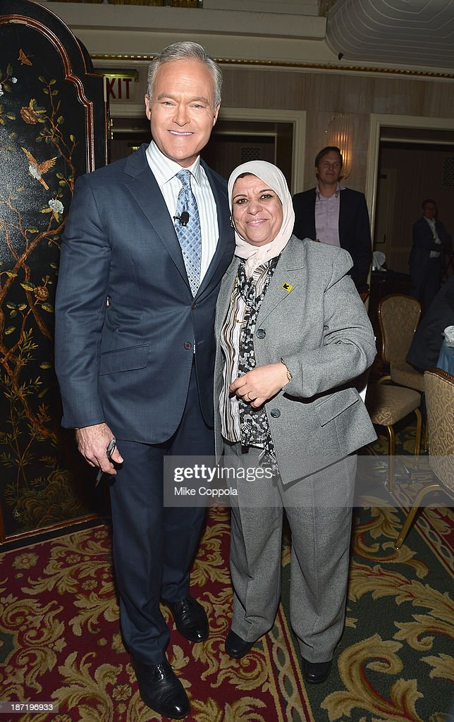 News anchor <a gi-track='captionPersonalityLinkClicked' href=/galleries/search?phrase=Scott+Pelley&family=editorial&specificpeople=5402652 ng-click='$event.stopPropagation()'>Scott Pelley</a> and Bushra Naji attend the Annual Freedom Award Benefit hosted by the International Rescue Committee at the Waldorf-Astoria hotel on November 6, 2013 in New York City.