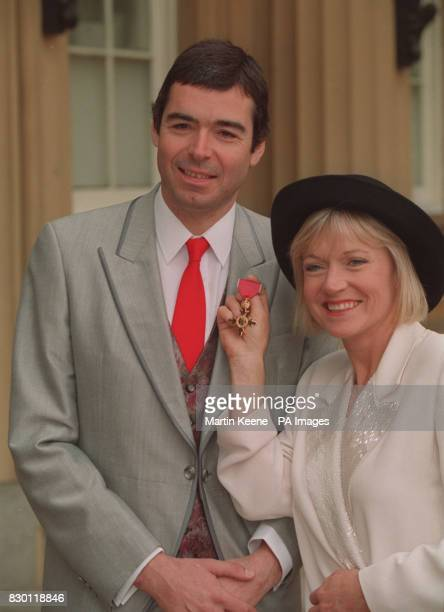 News cameraman Nigel Thomson with his wife ITN newsreader Carol Barnes at Buckingham Palace after he received an OBE * 15/3/04 Carol Barnes' daughter...