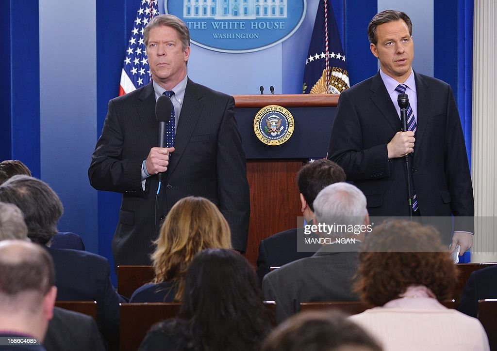 CBS News Chief White House correspondent Major Garrett (L) and ABC News Senior White House correspondent (R) appear in their stand-ups before US President Barack Obama arrived to deliver a statement in the Brady Briefing Room of the White House on December 19, 2012 in Washington, DC. Tapper will join CNN as anchor of a new weekday program and CNN's chief Washington correspondent. AFP PHOTO/Mandel NGAN