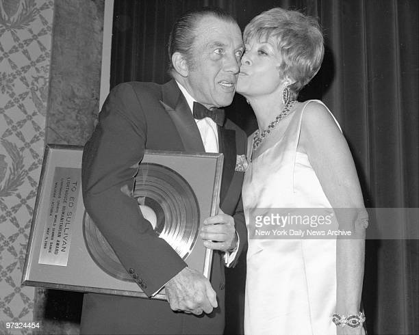 News columnist Ed Sullivan is kissed by wife Sylvia following presentation of Gold Record during Lighthouse Sports World Dinner at the WaldorfAstoria