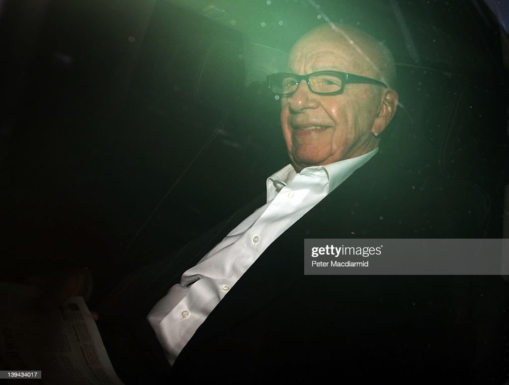 News Corp. CEO <a gi-track='captionPersonalityLinkClicked' href=/galleries/search?phrase=Rupert+Murdoch&family=editorial&specificpeople=160571 ng-click='$event.stopPropagation()'>Rupert Murdoch</a> smiles as he leaves his flat on February 21, 2012 in London, England. Mr Murdoch has announced that a new paper 'The Sun on Sunday' will publish it's first edition this weekend.