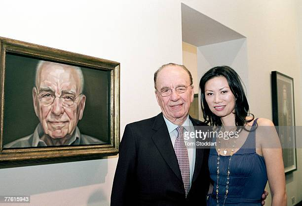 News Corporation Chairman and CEO Rupert Murdoch and his wife Wendi photographed in front of his portrait which was painted by British artist...