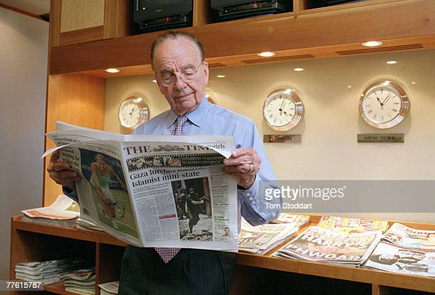 News Corporation Chairman and CEO Rupert Murdoch photographed holding a copy of The Times in his office at News International in Wapping London