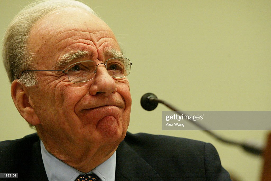 News Corporation Chairman and CEO Rupert Murdoch reacts during a hearing before the House Committee on the Judiciary May 8 2003 on Capitol Hill in...