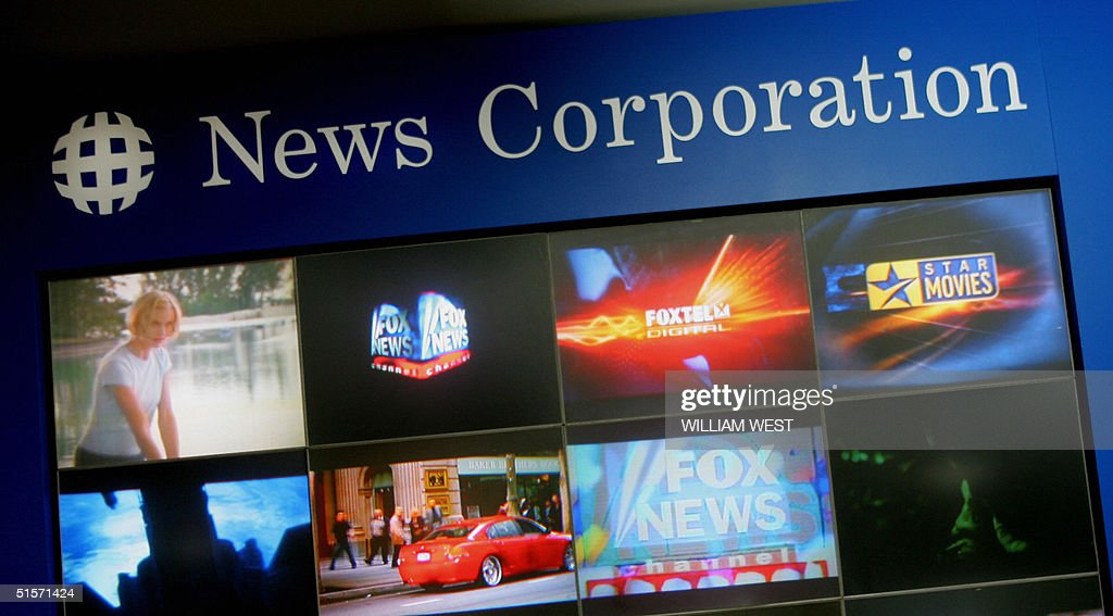 A News Corporation display showcases the many companies that make up the group, during the AGM held in Adelaide 26 October 2004. News Corp shareholders are expected to vote in support of Murdoch's plans to move his media empire's headquarters to the United States. AFP PHOTO/William WEST