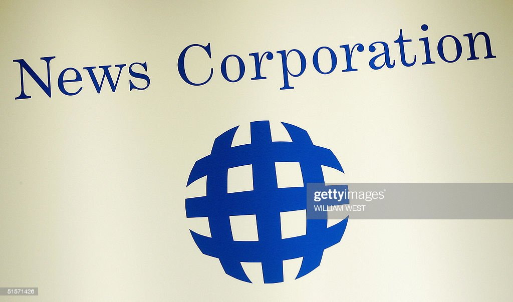 A News Corporation logo adorns the wall, during the AGM held in Adelaide 26 October 2004. News Corp shareholders are expected to vote in support of Murdoch's plans to move his media empire's headquarters to the United States. AFP PHOTO/William WEST