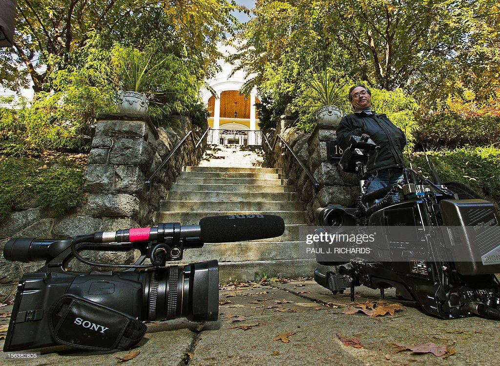 News crews stake out the front of a house, reporteldy owned by a Broadwell family member, where allegedly Paula Broadwell is staying on November 14, 2012, in the Mt. Pleasant area of Washington, DC. CIA Chief David Petraeus resigned last week when it became clear his affair with 40-year-old military reservist Paula Broadwell, who travelled to Afghanistan to write a fawning biography of him, would become public. FBI agents stumbled on the liaison after a complaint from Jill Kelley -- a close friend of both Petraeus and Allen -- who told a federal agent she had received threatening emails, which investigators later traced to Broadwell. AFP PHOTO/Paul J. Richards