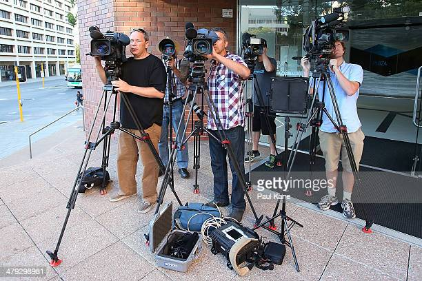 News crews wait outside the Hyatt Regency Perth where Mick Jagger and the Rolling Stones are staying during the first leg of their Australian tour on...