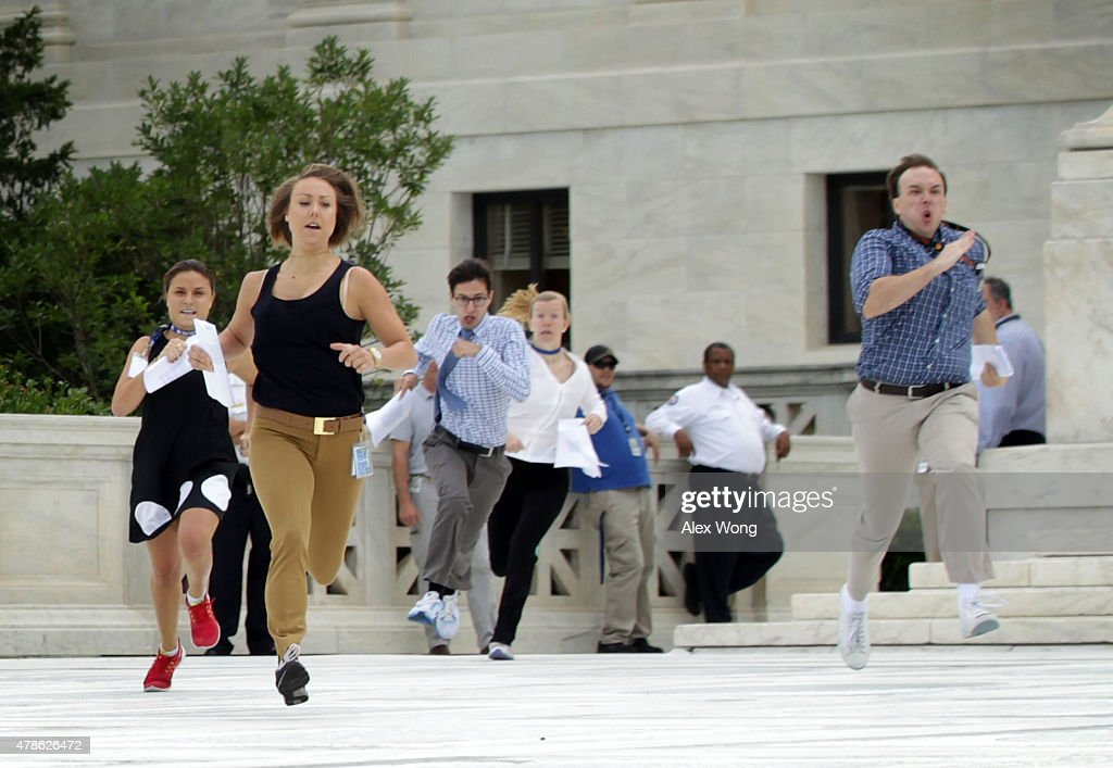 News interns run out with the ruling regarding samesex marriage from the US Supreme Court June 26 2015 in Washington DC The high court ruled that...