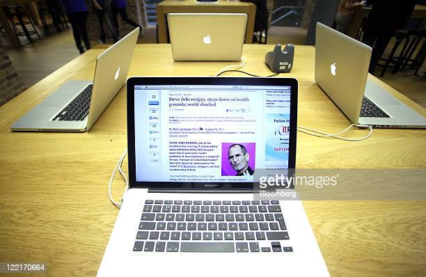 A news item about Steve Jobs's resignation as chief executive officer of Apple Inc is displayed on a Macbook Pro laptop computer at the company's...