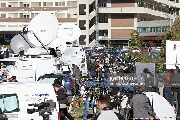 News media satellite dishes and trucks crowd outside the Policlinico Gemelli hospital in Rome 02 February 2005 Pope John Paul II was said to be in a...