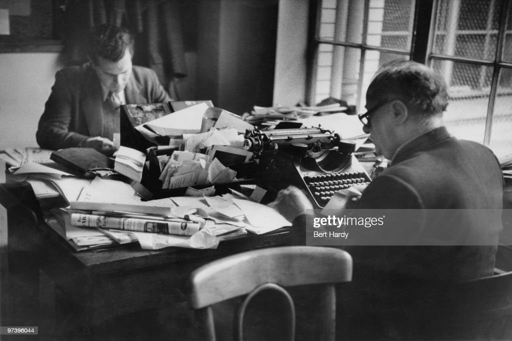 News Of The World crime reporter Norman Rae (right) at the paper's offices in London, April 1953. Original publication: Picture Post - 6488 - The 'News Of The World' - pub. 18th April 1953