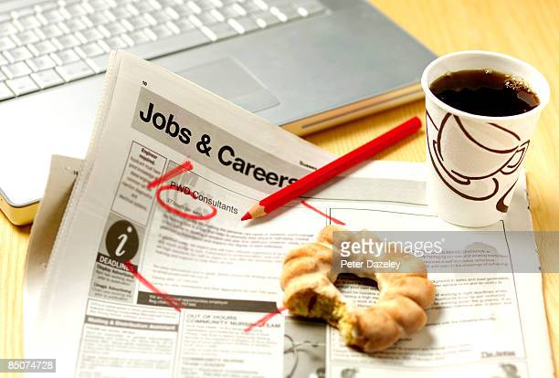 News paper jobs and careers page with coffee.