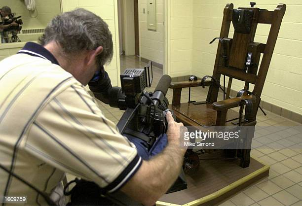 A news photographer collects video of the electric chair in the death chamber at the Southern Ohio Correctional Facility August 29 2001 in Lucasville...