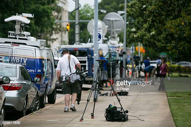 News photographer prepare for an evening live shot outside of the Governor's Mansion in Raleigh NC on Monday May 9 2016 Gov Pat McCrory and his...