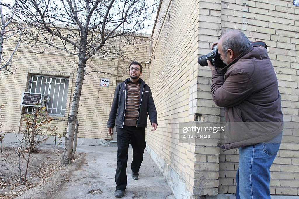 A news photographer takes pictures of Sajjad Qaderzadeh, son of Iranian 43-year-old Iranian Sakineh Mohammadi-Ashtiani who has been sentenced to death by stoning for adultery, as he leaves a guesthouse belonging to a government welfare organisation after giving an interview to a group of journalists from international news networks in Iran's northwestern city of Tabriz on January 1, 2011. Qaderzadeh, who was released on bail on December 12, 2010, said that his mother was guilty of murdering his father and that he made her case controversial to save her.