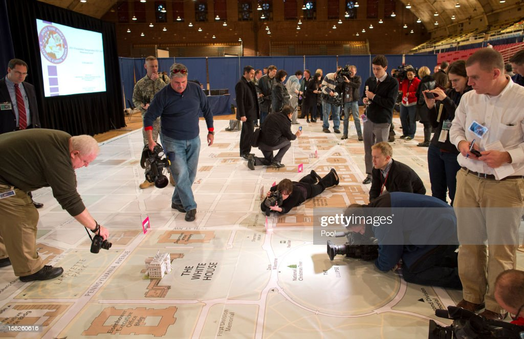 News photographers take photos of a giant planning map during a media tour highlighting inaugural preparations being made by the Joint Task Force-National Capital Region for military and civilian planners December 12, 2012 in Washington, DC. President Barack Obama will be sworn in for his second term as the President of the United States during a private ceremony on January 20 and a public ceremony on January 21, 2013.