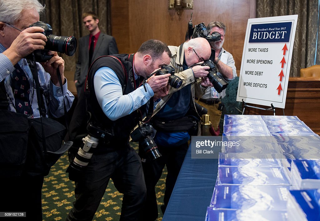News photographers take photos of the Presidents FY2017 Budget in the Senate Budget Committee hearing room in the Dirksen Senate Office Building on Tuesday morning, Feb. 9, 2016.